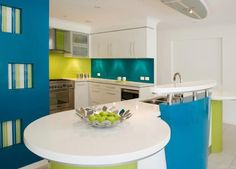 Turquoise dining, lime kitchen, purple living room accent colors!