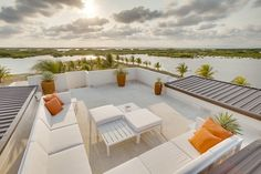 Openness Rooftop Terrace With White Comfy Metal Sofa And Orange Cushions Also Sky Views Design Ideas: Luxury Property in Belize, Wild Orchid Marina Residential Complex