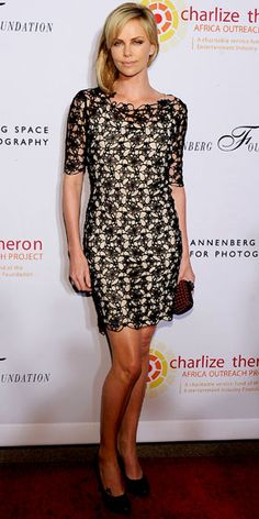 Charlize Theron in Christian Dior at an Africa Outreach Project event in October 2011