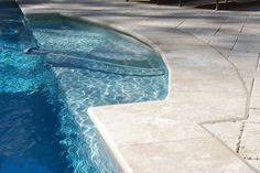 Gold travertine pool coping