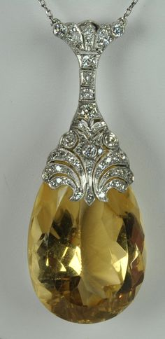 An absolutely exquisite citrine and diamond pendant from the Art Deco period (1920).. $5,200.00, via Etsy.