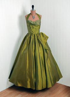 Evening wear, circa 1950.  Moonlight, the scent of jasmine, big band music playing in the courtyard...