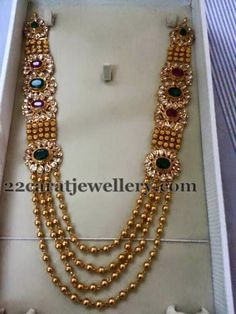 Jewellery Designs: Gold Beads Set with Large Motifs