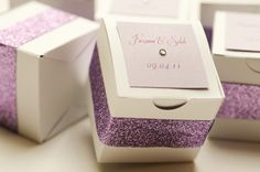 purple and white favor boxes. Photo by www.marcellatreybigphotography.com