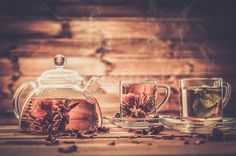 Teapot and glass cups with  tea against wooden background  stock photo (c) Nejron (#4594834) | Stockfresh