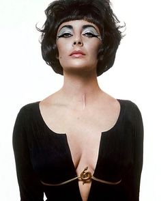 Elizabeth Taylor has described the filming of Cleopatra (during which she fell in love with Richard Burton) as probably the most chaotic time of my life but youd never know it by looking at the sitting she did for the January 1 1962 issue of Vogue. Both the photographer and hairdresser the great Alexandre flew to Italy for the six hour shoot in which Taylor wears a plunge-neck costume by Irene Sharaff secured by a golden asp. #Vogue125  via VOGUE MAGAZINE OFFICIAL INSTAGRAM - Fashion…