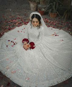This beautiful nikkah bride chooses for her big day. Looking gorgeous in an elegant ivory look with… Pakistani Wedding Outfits, Indian Bridal Outfits, Pakistani Bridal Dresses, Pakistani Wedding Dresses, Pakistani Dress Design, Bridal Lehenga, Bridal Gown, Nikkah Dress, Shadi Dresses