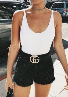 white bodysuit + pearl gucci belt + black jean shorts
