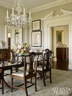 A crystal chandelier from Baccarat takes center stage in the dining room. The rug from Moattar set the tone for the soft green color palette.