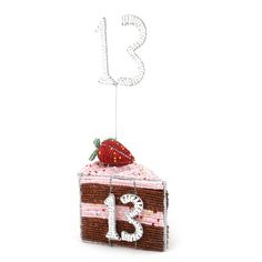 Beaded slice of cake centrer-piece with table number. This will certainly get the clients talking!