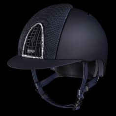 A unique combination of protection and glam: matt blue outer cap with blue python leather front and back inserts. Swarovsky crystals on the frontal grid make this super luxury helmet a real must have!