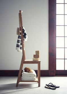 IKEA Fan Favorite: RÅGRUND bamboo chair and towel rack. This product helps to save room because you get both a chair and a towel rack in the same space.