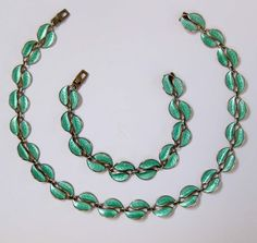 """The delicate set created with vermeil Sterling silver with brilliant light green guilloche enamel and has very attractive Modernistic split leaves design. Measure of necklace is 16"""" in length and 1/2"""" wide. 