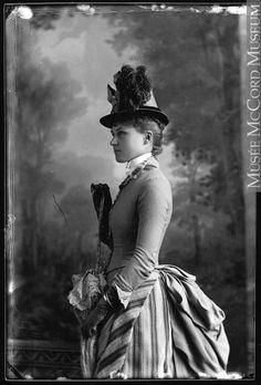 Wonderful Victorian bustle fashion, striped dress, 1886.
