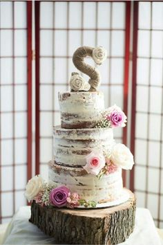 The beautifully crafted semi naked cake my awesome sister-in-law created for our special day. Perfect for our rustic themed wedding.  And it was funfetti ♡♡
