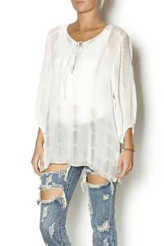 Sheer white blouse with a grey tie dye wash, lace up front and elasticized cuffs. Wear this top tucked into make skirts for an effortless weekend outfit.