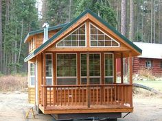Tiny House Living: Spacious Cabin on Wheels with Large Windows-Love all the windows. I would put either double french doors that swing out or a wall of windows door that slide or fold to create indoor/outdoor living. Tiny Cabins, Tiny House Cabin, Cabins And Cottages, Tiny House Living, Tiny House Plans, Tiny House On Wheels, Log Cabins, House 2, Tiny House Movement