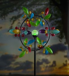 Our Kaleidoscope Wind Spinner with Crackle Glass Solar Ball features six independent spinning rays with metal leaves and mini cups painted in vibrant colors. Each creates a brilliant, multidimensional show in and around a center ring – you'll be mesmerized by the hypnotic, kaleidoscopic effect!