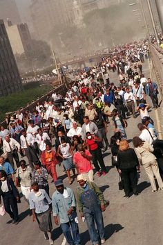 Evacuees walk across the Brooklyn Bridge from downtown Manhattan where earlier two hijacked airliners crashed into the World Trade Center and brought down the twin 110-story towers Tuesday, Sept. 11, 2001. A jetliner also slammed into the Pentagon as the seat of government itself came under attack.  (AP Photo/Jim Collins) Photo: JIM COLLINS / j=adv_sep11_wirephotos