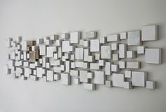 #white #clay #installation #geometric #totalwhite #art ThinkingThroughThings #CERAMIC SERENITY ON THE WALL BY VALERIA NASCIMENTO