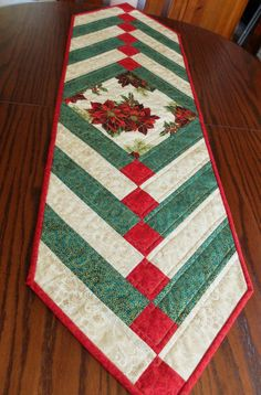 Christmas patchwork tablerunner. French Braid by StephsQuilts