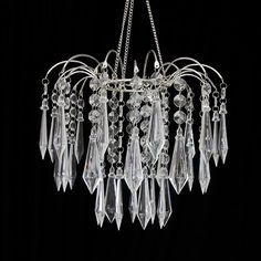 This is a dazzling chandelier with large radiant crystals. The chandelier is Large Crystals, Crystals And Gemstones, Romantic Wedding Centerpieces, Chandelier, Ceiling Lights, Candelabra, Chandeliers, Outdoor Ceiling Lights, Candle Holders