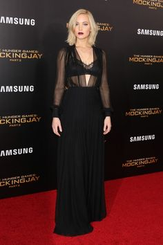 Jennifer Lawrence wears a lace bra, sheer blouse, and black maxi skirt