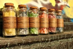 Brooklyn Hard Candy comes in these adorable little vials with corks. Six different colors/flavors: golden pineapple, grape, green apple, tangerine, wild strawberry and blueberry.
