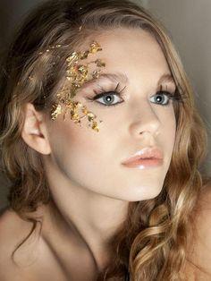 gold flecks and false eyelashes