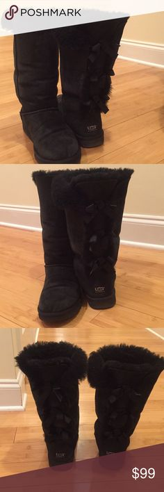 Ugg boots with bow backs Cute pair of black ugg boots. The bow details in