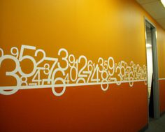 Incredibly vibrant wall graphic application. Wall graphic with typography. Numbers.