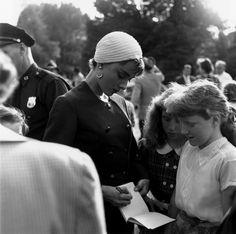 Audrey Hepburn signing an autograph on the set of Sabrina, c. 1953