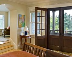 """Add a door with a screen to the front entry. Bottom would be need to be """"scratch proof,"""" thanks to the dog."""