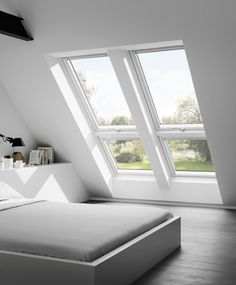 Loft conversion with double velux windows to provide light and view