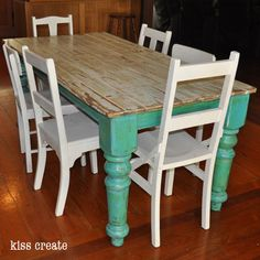 Old door table. Vintage style with old chairs. Upcycled old tables legs with old door which was distressed to show a life of colours.  Found old mix matched chairs to finish of perfectly.  www.kisscreate.com