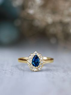 Pear Shaped London Blue Topaz and Diamond Halo 14K Gold Engagement Ring