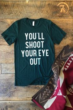 """You'll shoot your eye out"" Christmas graphic t-shirt. Get yours today!"