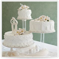 Callie:  Breathtaking in its versatility, each of these three tiers has a unique design all its own and is accented with perfectly formed gum paste Calla Lilly flowers.    The two smaller tiers provide a dramatic backdrop for the bride and groom figurines.  #bakery #cake #wedding