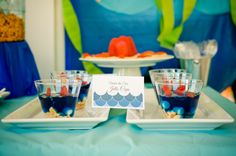 Under the sea party jello cups.  Cute idea, blue jello and mixins that look like the ocean.