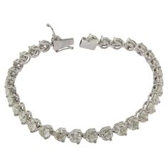 Stunning 18ct White Gold, 10.33ct Diamond Tennis Bracelet valued at $28,084 #auction #graysonline #diamond #bracelet