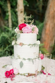 Pink hued flower topped wedding cake | Photography: Jenny Quicksall - https://www.jennyquicksall.com/
