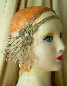 astrid - art nouveau flapper headband with 1920s metallic trim, antique, hand beaded metallic lace and vintage feathers. $85.00, via Etsy.