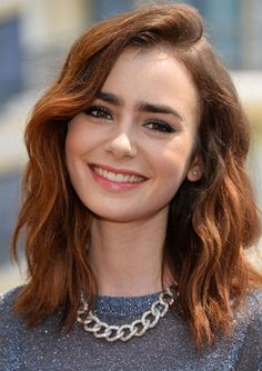 GET THE LOOK: LILY COLLINS'S CHUNKY STATEMENT NECKLACE - Lily teams a sparkly sweater with a chunky silver chain