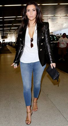Trending Fashion Style: Men's Jacket. Kim Kardashian in Balmain black leather blazer + denim pants + golden sandals NYC March 2014.