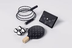 Louis Vuitton Released Some Lavish, Black Monogram Stocking Stuffers: Jump rope, ping pong paddles and playing cards. Table Tennis Set, Monogram Stockings, Louis Vuitton Australia, Neverfull Gm, Glamour, Sports Luxe, Clothes Horse, Sports Equipment, Stocking Stuffers