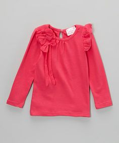 Graced with fun frills and bow accents, this all-cotton top provides all-day comfort while also enhancing a little lady's inner princess, be it playtime or dressy affairs.