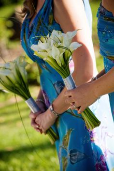 Sarah, this is NOT a pin for the dresses, lol!  But I thought the simple Calla Lilly bouquets were pretty :)
