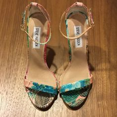 Multi-color Steve Madden Heels This is a multi-color faux snake skin sandal from Steve Madden in excellent condition. Worn only one time. The colors seem to be light pink/green/berry. Heel night is 4 inches. Steve Madden Shoes Sandals