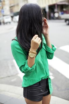 mint button down shirt, leather shorts, gold watch