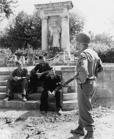 German soldiers captured by units of the 36th Infantry Division in the US Loriol (Loriol), France. On the background monument to the fallen in the 1st World War.